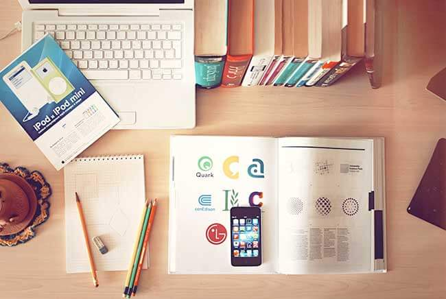 apple-iphone-books-desk-in-article